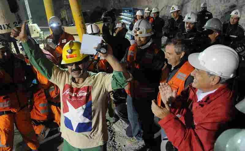 Juan Illanes celebrates his rescue.
