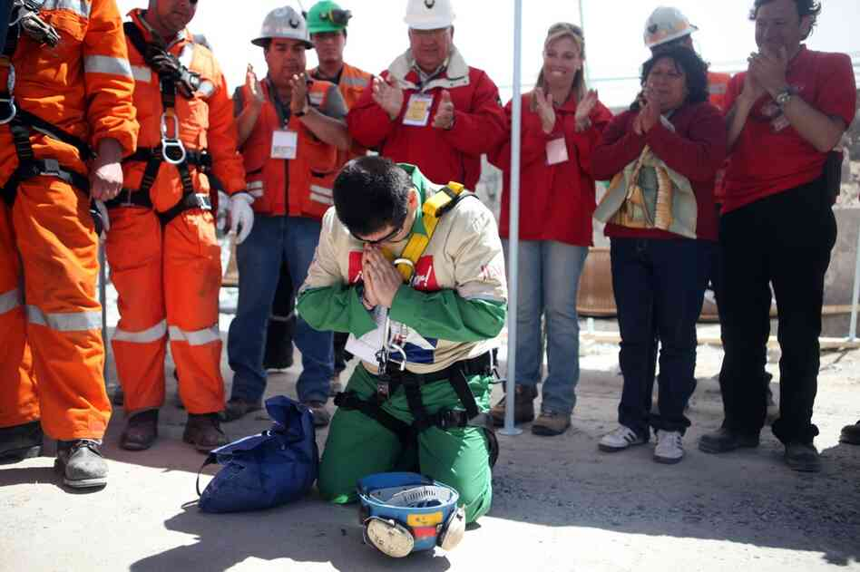 Esteban Rojas, 44, prays after being rescued from the San Jose gold and copper mine, near Copiapo, Chile, on Wednesday. Rojas is one of 33 miners who have been trapped a half a mile below ground since the Aug.5 collapse of the mine.