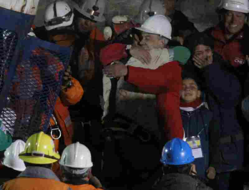 President Pinera embraces Avalos after his rescue.