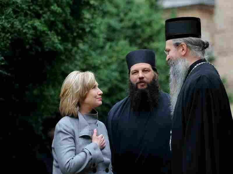 U.S. Secretary of State Hillary Clinton talks with Bishop Teodosije.