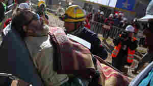 The 11th rescued miner is carried on a stretcher