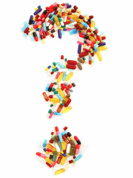 A question mark formed from pills and capsules