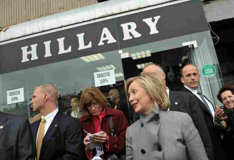U.S. Secretary of State Hillary Clinton walks out of a store named in her honor in Pristina.