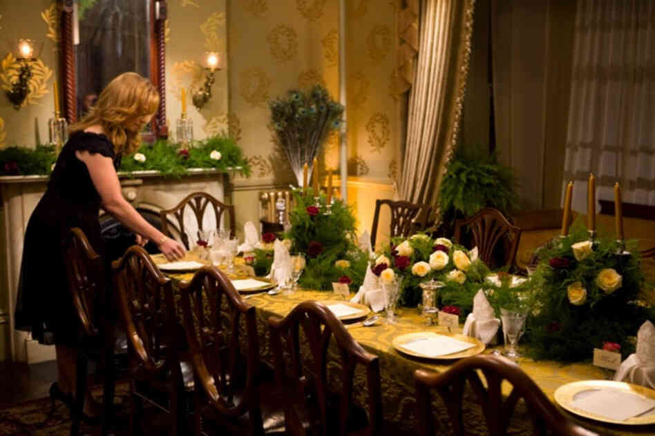 Chris Kimball's wife, Adrienne, prepares the back parlor of their 1859 Victorian home for the 12-course meal featured in Fannie Farmer's Last Supper.
