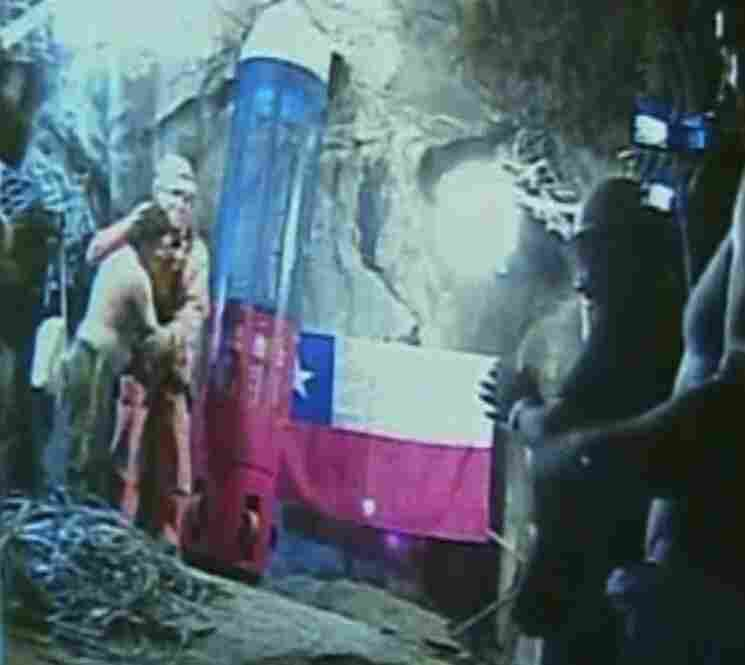 In this screen grab taken from video inside the mine, rescuer Manuel Gonzalez Pavez (second from left) is greeted by the trapped miners.