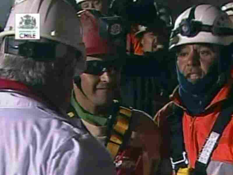 At 12:11 a.m. local time, the first miner, Florencio Avalos, emerged from the mine. In a din of cheers, he hugged his sobbing 7-year-old son and wife.