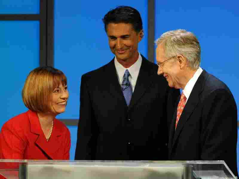 Nevada Sen. Harry Reid (right) talks to his opponent, Republican Sharron Angle.
