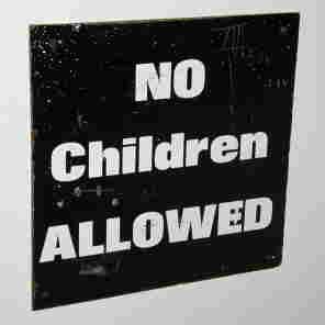 "A sign reads ""NO Children ALLOWED."""