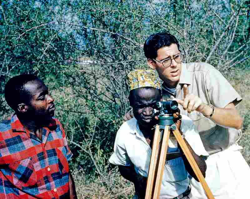 Gene Schreiber shows local municipalities how to survey for road construction, 1962