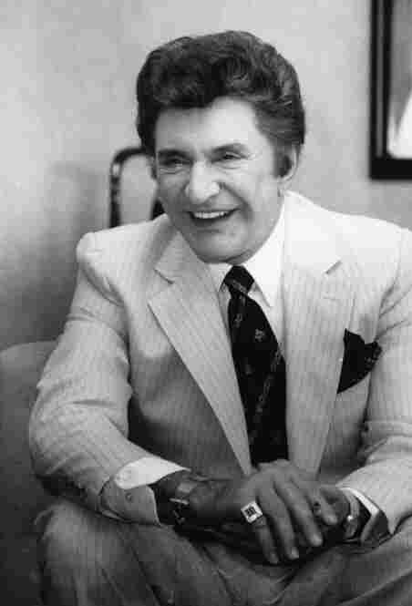 Liberace is interviewed in his hotel room in New York on April 11, 1984, where he is practicing for his two-week performance at Radio City Music Hall.