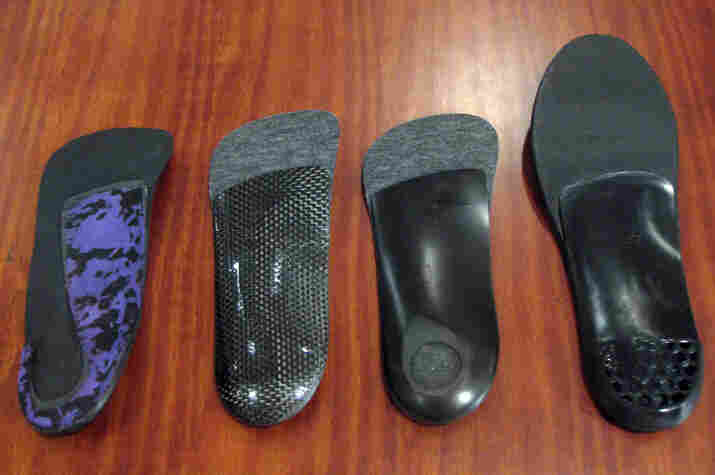 The Cobra (far left) is for heel heights greater than 2 inches. It fits in most women's shoes but isn't as supportive as other orthotics. The Graphite Dress (second from left) is lightweight but bulkier than the Cobra, and only works with shoes with less than a 2-inch heel, including men's shoes.  More supportive than the Cobra is the Holethotic (second from right) for heel...