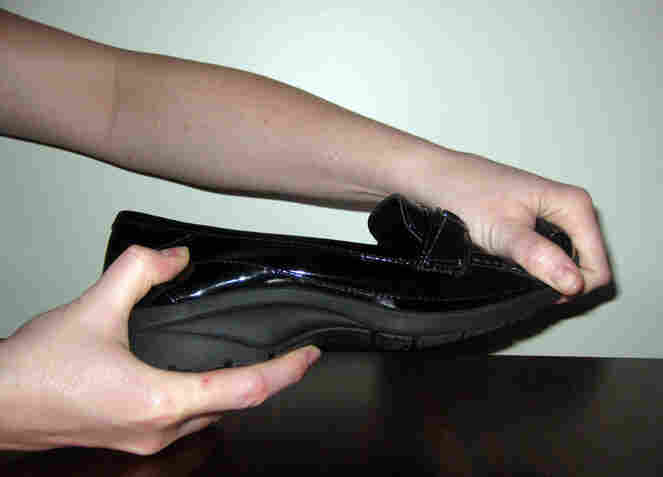 Shoe soles should be stiff, like this one, for optimal support, Cook says. When shoes twist easily, our muscles compensate, making for tired and sore feet. Test shoe stiffness by gripping each end of the shoe and making a twisting motion, like wringing out a towel.