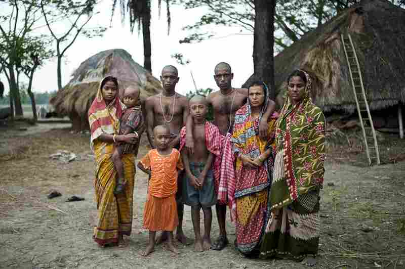 The family of Niren Sarkar, a 55-year-old fisherman, poses for a portrait. The fisherman was killed in the jungle five days earlier. Sarkar's sons will continue fishing in the forest to support the family, as other jobs are scarce.