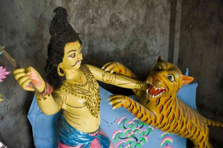 "Tigers are a menace to villagers in the Sundarban region of India and Bangladesh — but are still an integral part of local culture. Traditionally, the tiger is believed to be an incarnation of a mystical demon named ""Dakkhin Rai."""