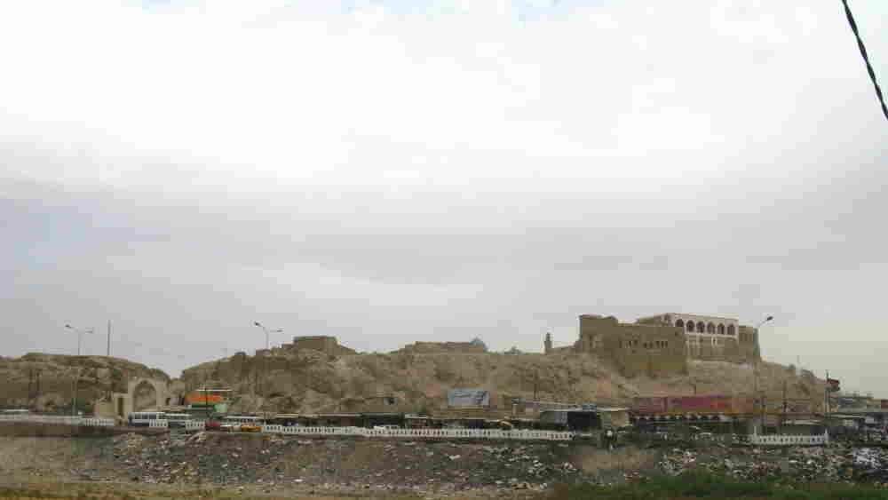 Kirkuk's ancient citadel is seen from a distance.