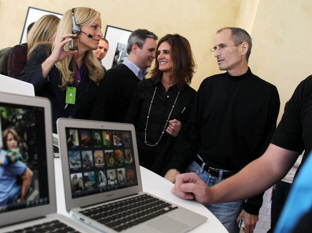 Apple CEO Steve Jobs looks at the new MacBook Air at the company's Cupertino headquarters.