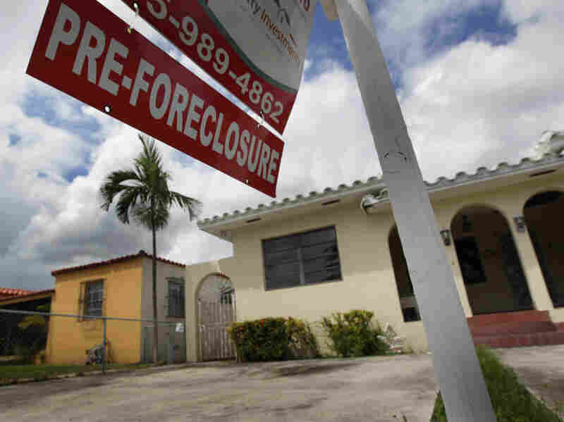 A pre-foreclosure sign hangs in front of a home in Miami, Florida.