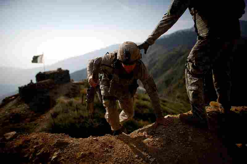 U.S. soldiers on patrol in Kunar province climb the hills and footpaths near the Pakistan border. Whoever left the compound, about two weeks ago, left this part of the border unprotected, with no explanation to the soldiers here as to why they pulled out without waiting for replacements.