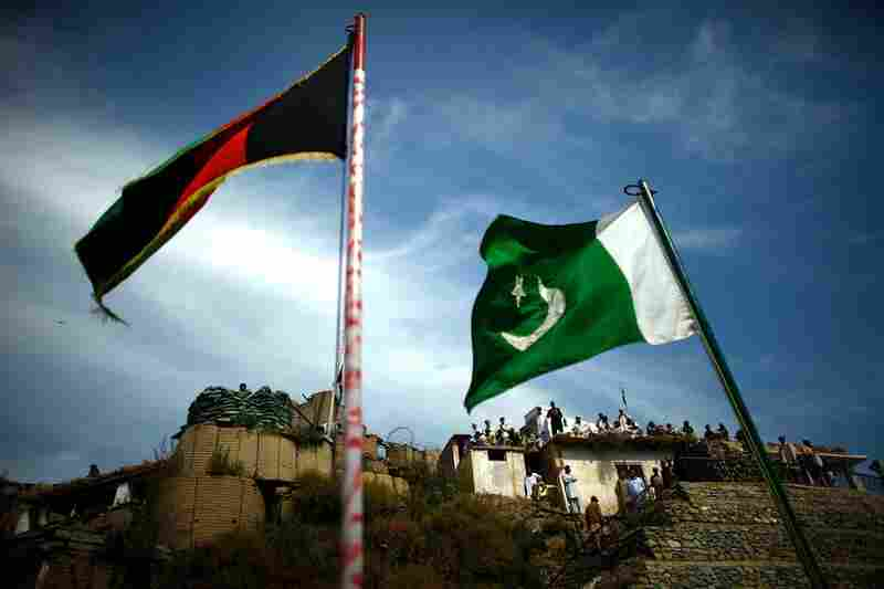 Flags fly at the Afghanistan-Pakistan border. On the rooftops, the Lashgar are members of the local Pakistani population who support the government — an informal posse fighting against the Taliban, as Salim says.