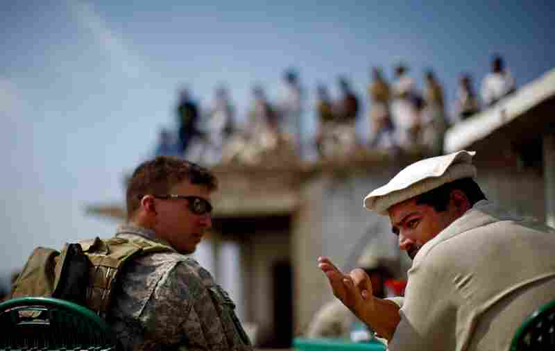 Billig shares a cup of tea and conversation with Pakistani Army Lt. Col. Ahmed Salim at a border crossing at Ghakhi Pass. Salim invites the Americans across the border for lunch. On the roof are three dozen men with beards, turbans and Kalashnikov rifles. They're not Taliban, Salim insists, but pro-government militiamen.