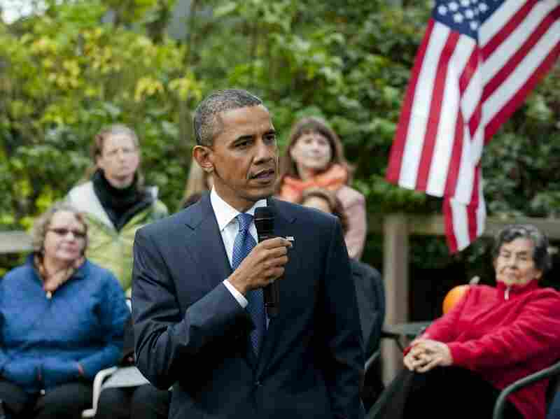 President Obama speaks at Erik and Cynnie Foss' backyard in Seattle on Thursday.