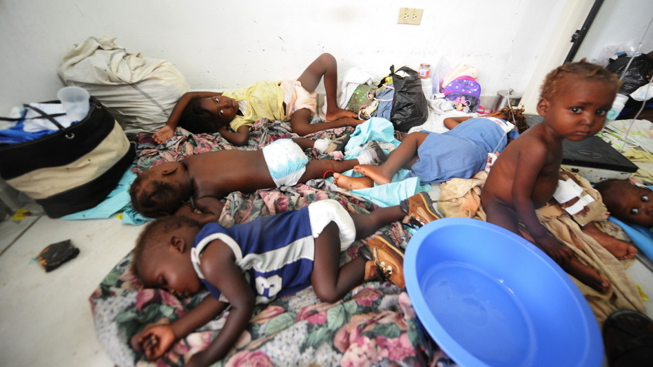 Children await treatment at a medical facility in St. Marc, northern Haiti, amid a cholera epidemic that has claimed more than 100 lives and infected more than 1,000 people over the past few days.