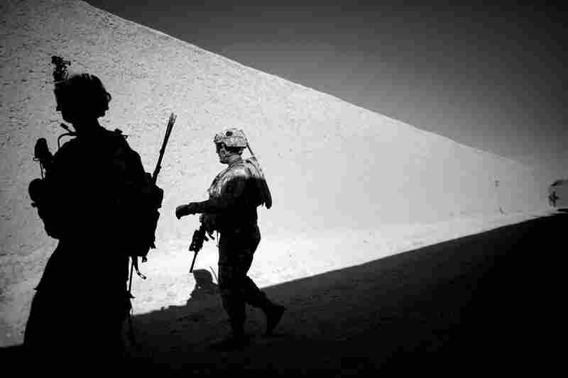 Soldiers from Alpha Company of the 101st Airborne Division walk beneath high mud walls that make up the labyrinth of alleyways and corridors of the village of Sangeray in Zhari district. In less than a week, there were five grenade attacks, injuring more than a half-dozen U.S. forces and Afghan troops. July 2010
