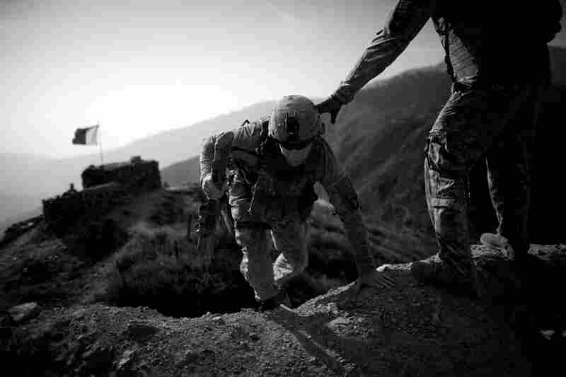 U.S. soldiers on patrol in Kunar province climb the hills and footpaths near the Pakistan border. This volatile border has been a source of constant friction as insurgents pass freely through the mountainous region. October 2010