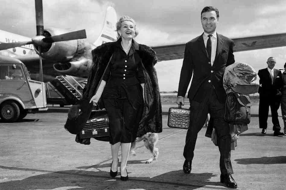 Gabor and Porfirio Rubirosa arrive at the Orly Airport in Paris on May 2, 1955.