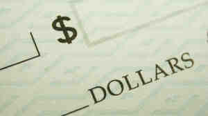 The Federal Reserve says the number of checks it processes each year has dropped dramatically.