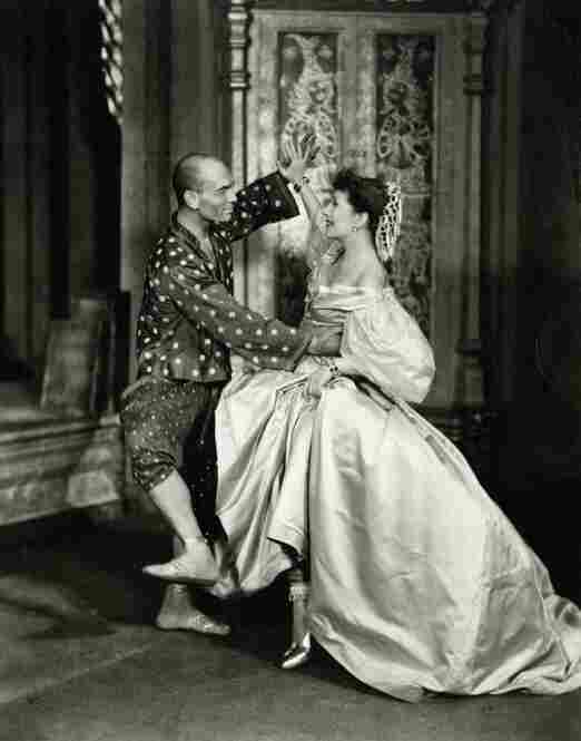 "King Mongkut of Siam (Yul Brynner) and schoolteacher Anna Leonowens (Gertrude Lawrence) perform ""Shall We Dance?"" in the 1956 film adaptation of Rodgers & Hammerstein's The King and I."