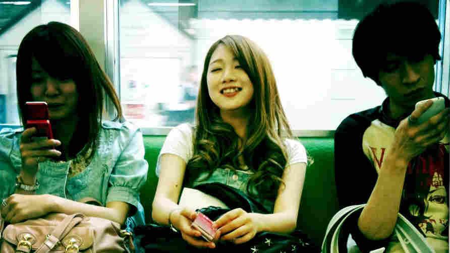 Japanese Teens On Tokyo Subway