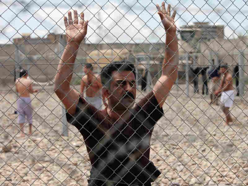 An Iraqi prisoner at al-Muthanna prison in Baghdad, Iraq. AP File Photo/Karim Kadim