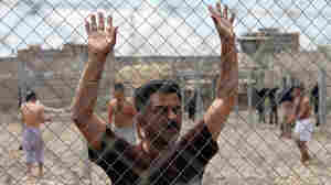 An Iraqi prisoner at al-Muthanna prison in Baghdad, Iraq. AP File Photo/Karim Kadim