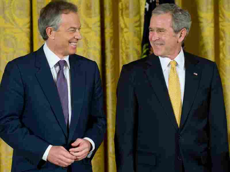 Former U.S. President George W. Bush with former British Prime Minister Tony Blair.