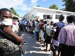 Sick people wait in line at St. Nicolas Hospital north of Port-au-Prince.