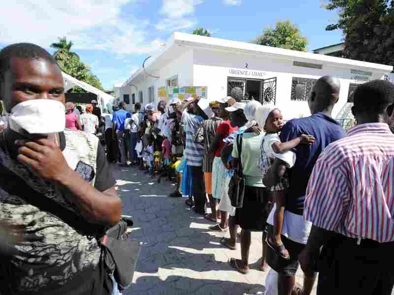 Sick people wait in line at St. Nicolas Hospital north of Port-au-Prince.