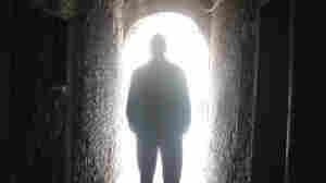 man heading towards the light