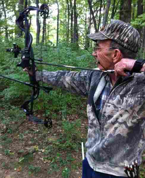 Retiree Roy Duncan of Nashville takes aim at a target.