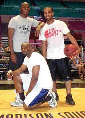 Writer Darren Sands poses with friends after a game of basketball.