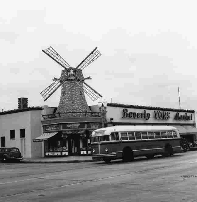 A Los Angeles Railway bus travels past a Van de Kamp's Bakery in Beverly Hills.