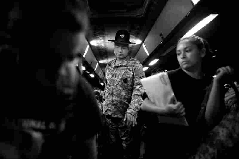 Drill sergeant Nicholas Pieroni gives instructions to arriving recruits before they get off a bus at the U.S. Army Training Center reception facility at Fort Jackson in Columbia, S.C.