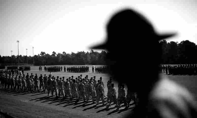 A drill sergeant watches the graduation ceremony for soldiers who completed basic training at Fort Jackson.
