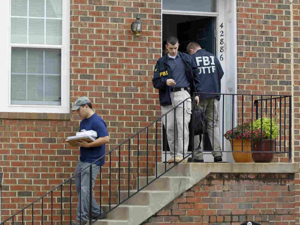 FBI investigators search the home of Farooque Ahmed, accused of a bomb plot in Washington.