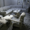 Furniture is covered by volcanic ash in a house in a village badly hit by the eruption of Mount Mera