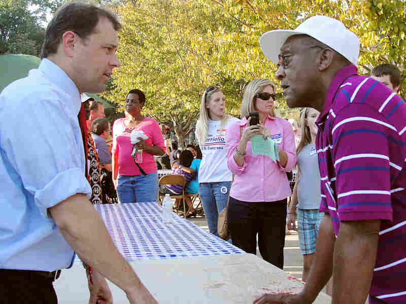 Rep. Tom Perriello (D-VA) talks with voter Charles Bailey