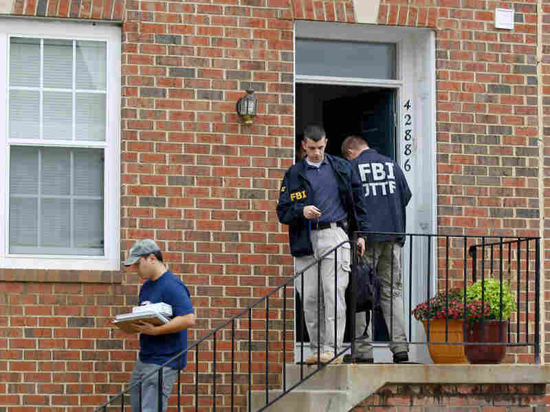 FBI Investigators leave the home of Farooque Ahmed in Ashburn, Va.,  on Wednesday.