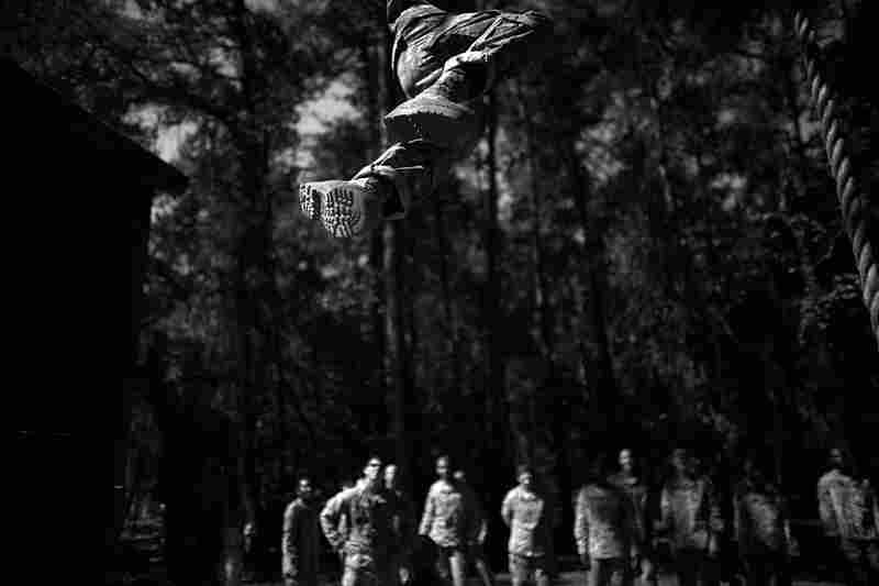 A soldier passes over head while competing a climbing exercise on one of the many traditional obstacle courses. The Army has found that 79 percent of soldiers who commit suicide do so during major transitions in their service. Basic training and the first three years of duty pose some of the toughest transitions for new soldiers.