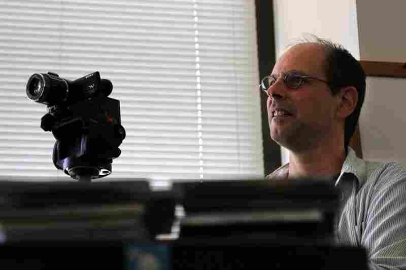 Bob Boilen adjusts a camera while recording a Tiny Desk Concert.