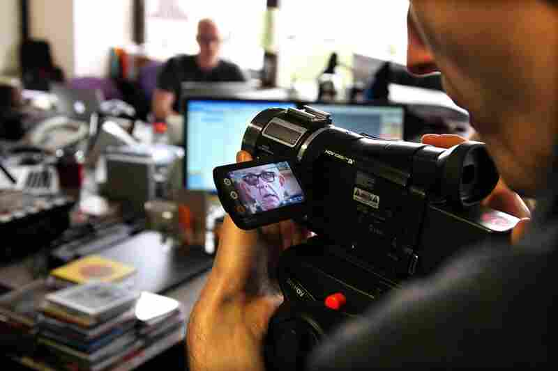 Nick Lowe is seen in a camera that NPR's Michael Katzif adjusts during his performance on October 19th.